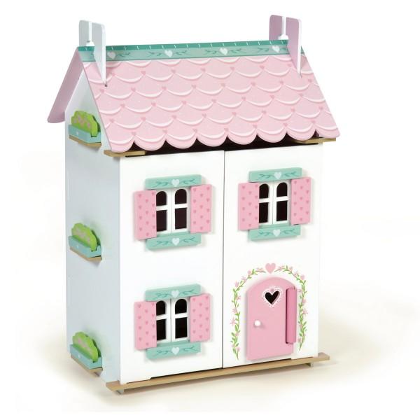 Kleines Puppenhaus mit Puppenhausmöbeln